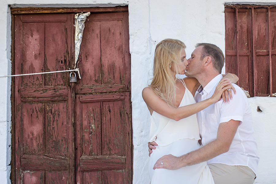 picture of a couple next to a vintage door