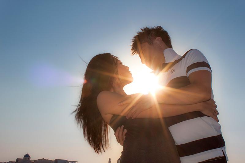 Romantic couple between sun rays