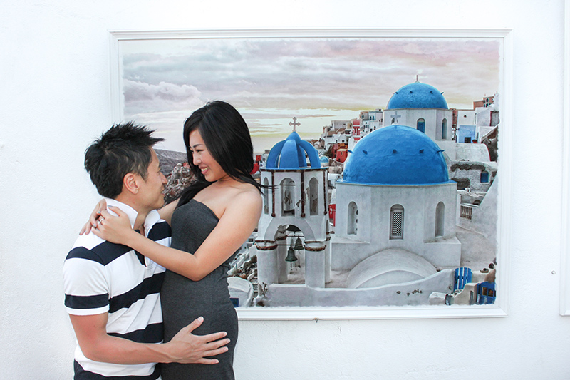 couple hugging in front of frame