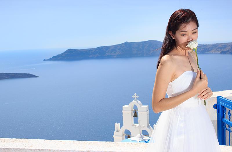 Bride smells a white rose