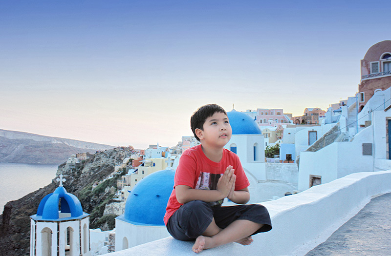 little boy looking up and praying to god