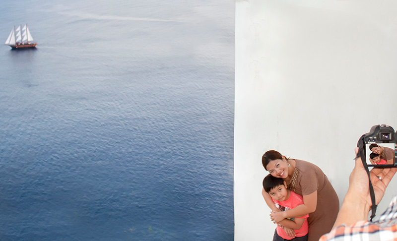 Mother from Philippines photographed with her son in Santorini