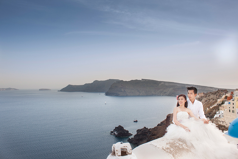 Chinese couple in Santorini Greece