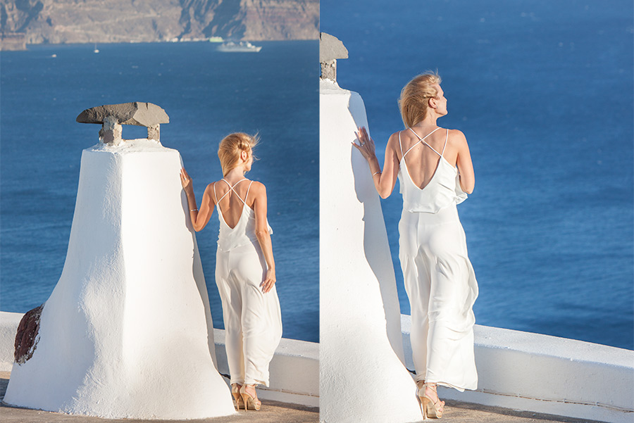 Model with a white dress staring at the aegean sea