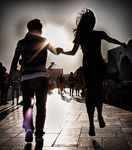 Couple jumps holding each other hand
