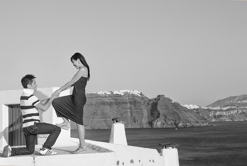 Derek standing on his knee and proposing Sara