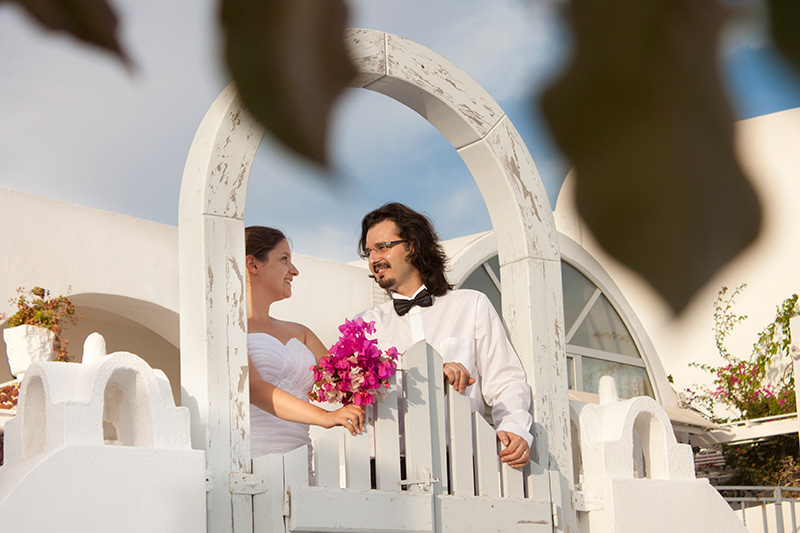 Just married picture at the balcony of their hotel