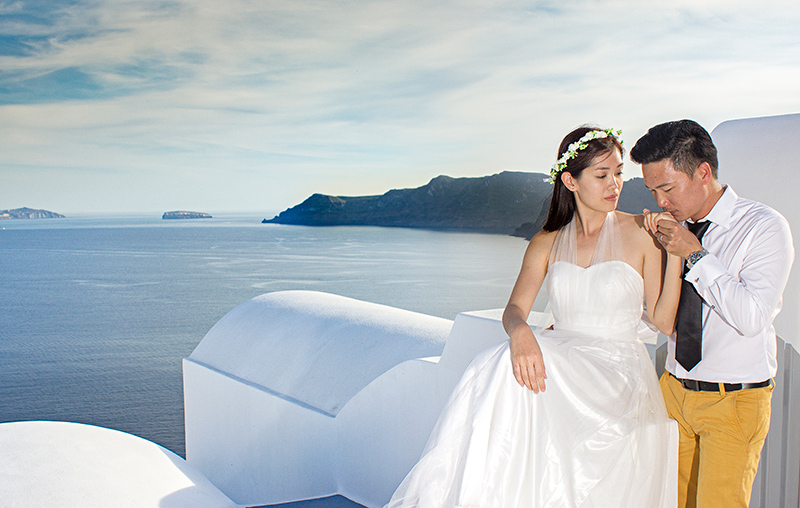 Romantic Santorini Pre wedding Photography Pose at the top of white houses