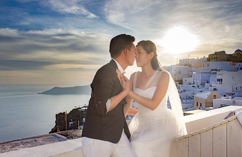 Romantic kiss under the sunset at the cliffs
