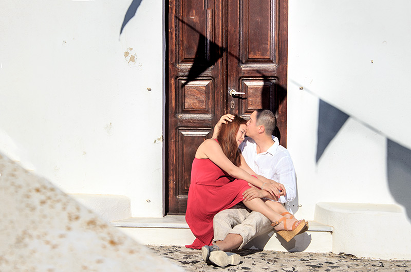 romance and kiss at front at the doorstep of wooden door