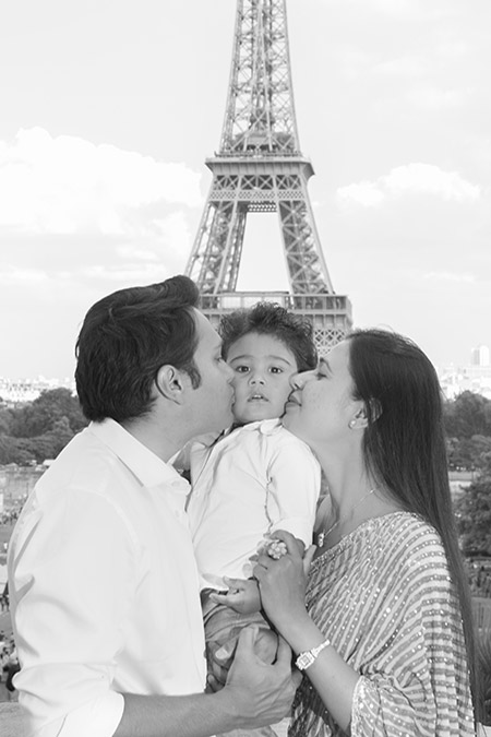 indian family with son at eiffel tower