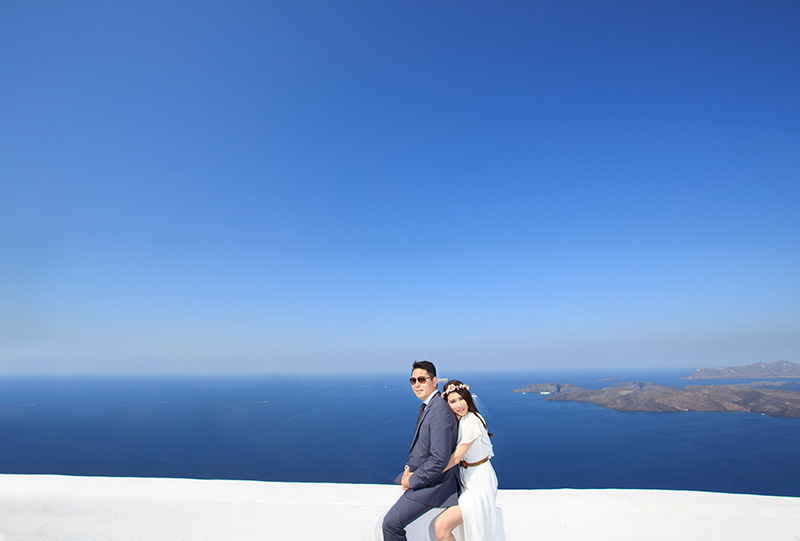 White colored dress for pre marriage photo session in greece