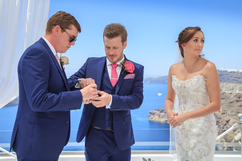 best man gives rings groom