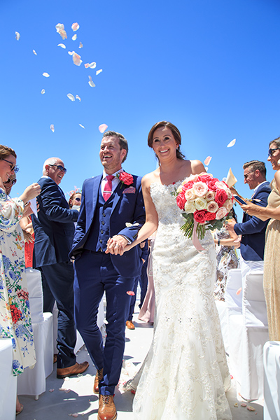 guests throw petals wedding
