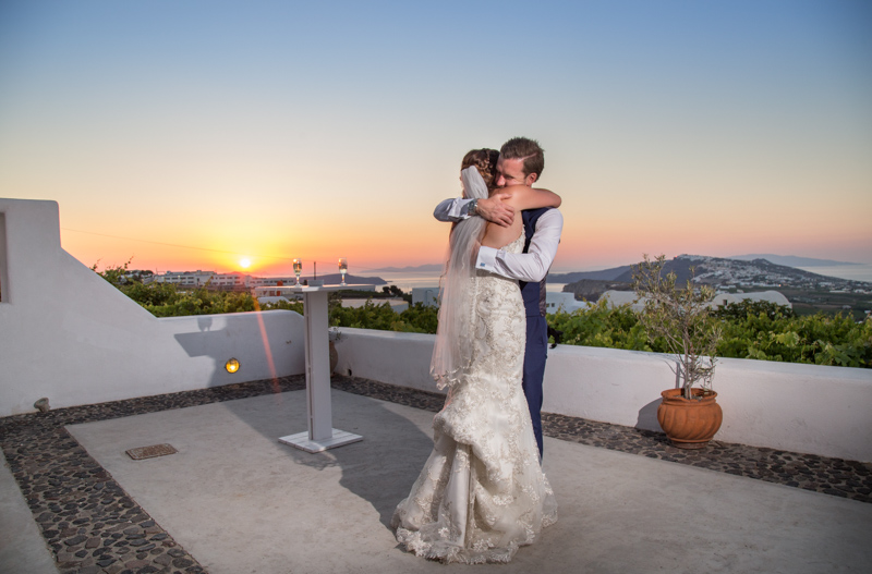 newly wed couple first dance sunset