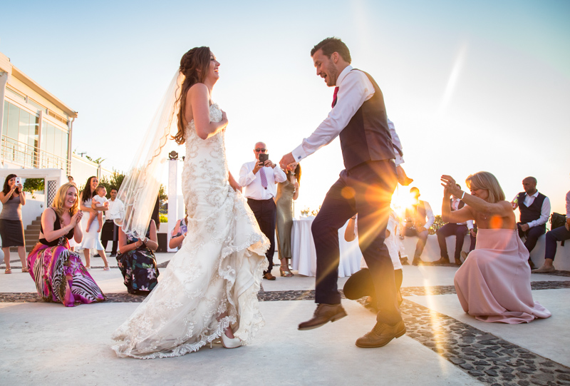 groom bride dance outdoors with guests