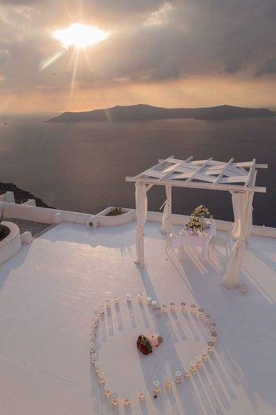 propose during sunset in Santorini