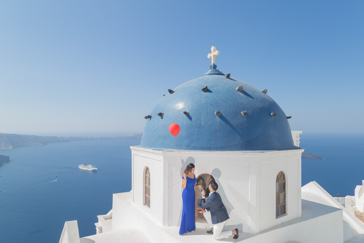 blue domed proposal santorini