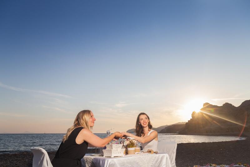 same sex proposal santorini sunset